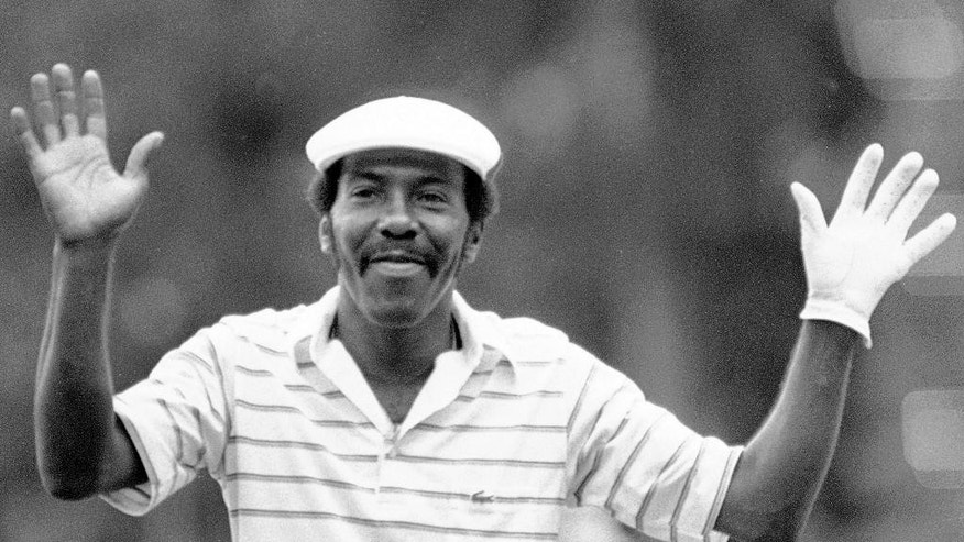 FILE - In this May 22, 1983, file photo, Calvin Peete holds his arms up in thanks to the gallery as they give him a standing ovation after he made a birdie on the 18th hole to win the Georgia Pacific-Atlanta Classic golf tournament in Atlanta. Peete, the most successful black player on the PGA Tour before the arrival of Tiger Woods, died Wednesday morning, APril 29, 2015. He was 71. (AP Photo/Joe Holloway  Jr., File)