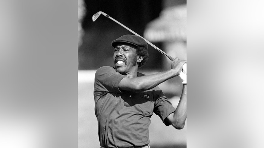 FILE - In this Jan. 20, 1983, file photo, PGA golfer Calvin Peete hits to the green during the Bob Hope Desert Classic golf tournament in Palm Springs, Calif. Peete, the most successful black player on the PGA Tour before the arrival of Tiger Woods, died Wednesday morning, APril 29, 2015. He was 71. (AP Photo/Lennox McLendon, File)