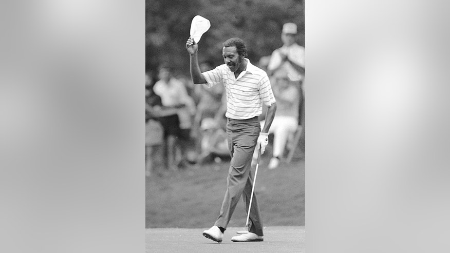 FILE - In this May 22, 1983, file photo, Calvin Peete tips his cap as the gallery gives him a standing ovation after he made a birdie on the 18th hole to win the Pacific-Atlanta Classic golf tournament in Atlanta. Peete, the most successful black player on the PGA Tour before the arrival of Tiger Woods, died Wednesday morning, April 29, 2015. He was 71. (AP Photo/Joe Holloway Jr. File)