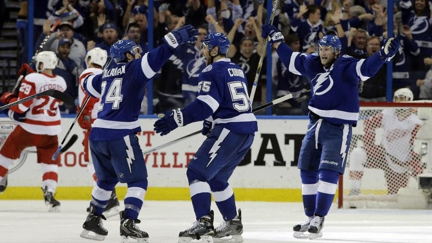Tampa Bay Lightning defenseman Braydon Coburn (55) celebrates his goal against the Detroit Red Wings with teammates right wing Ryan Callahan (24) and center Steven Stamkos (91) during the third period of Game 7 of a first-round NHL Stanley Cup hockey playoff series Wednesday, April 29, 2015, in Tampa, Fla. The Lightning won the game 2-0. (AP Photo/Chris O'Meara)