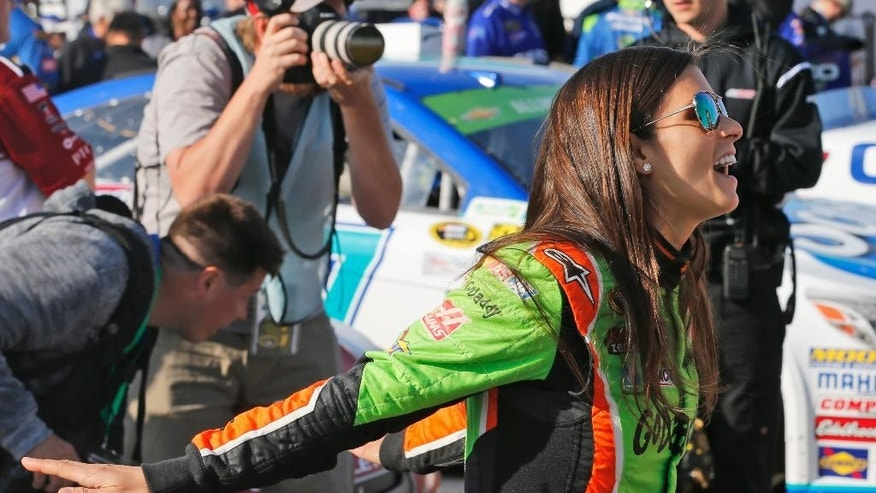 Driver Danica Patrick shares a laugh as she talks to Clint Bowyer and Ryan Newman prior to the start of qualifying Friday, April 24, 2015, for Saturday's NASCAR Sprint Cup auto race at Richmond International Raceway in Richmond, Va.  (AP Photo/Steve Helber)