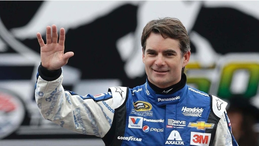 FILE - In this April 11, 2015, file photo, Sprint Cup Series driver Jeff Gordon waves during introductions before a NASCAR auto race at Texas Motor Speedway in Fort Worth, Texas. Jeff Gordon will drive the pace car for the Indianapolis 500 next month. He'll take the field to the green flag in the May 24 race, watch some laps with his wife and children, then fly to North Carolina to compete in NASCAR's Coca-Cola 600 that evening.  Chevrolet made the announcement Wednesday, April 29, 2015, at Indianapolis Motor Speedway  (AP Photo/Ralph Lauer, File)