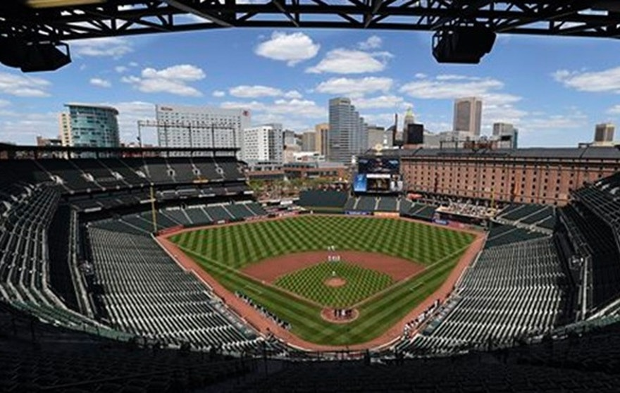 The Baltimore Orioles and Chicago White Sox pause during the National Anthem before a baseball game without fans Wednesday, April 29, 2015, in Baltimore. Due to security concerns the game was closed to the public.(AP Photo/Gail Burton)