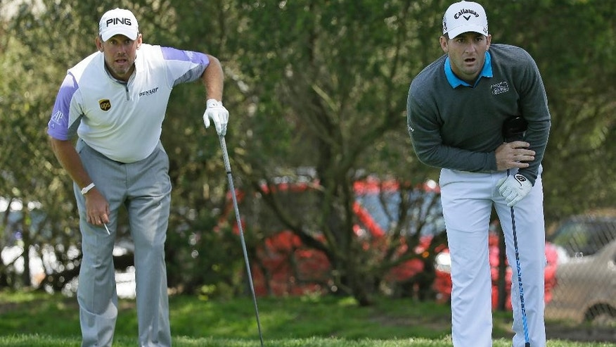 Matt Every, right, follows his drive from the fourth tee of TPC Harding Park during round-robin play against Lee Westwood, left, of England at the Match Play Championship golf tournament Wednesday, April 29, 2015, in San Francisco. (AP Photo/Eric Risberg)