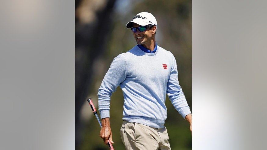 Adam Scott, of Australia, smiles walking off the second green of TPC Harding Park during round-robin play against Francesco Molinari, of Italy, at the Match Play Championship golf tournament Wednesday, April 29, 2015, in San Francisco. (AP Photo/Ben Margot)