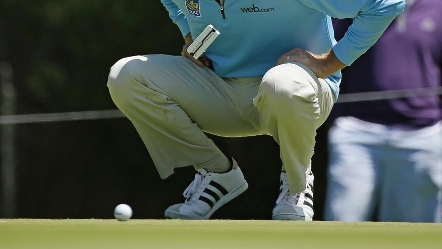 Jim Furyk bends down to read the second green of TPC Harding Park during round-robin play against George Coetzee of South Africa at the Match Play Championship golf tournament Wednesday, April 29, 2015, in San Francisco. (AP Photo/Eric Risberg)