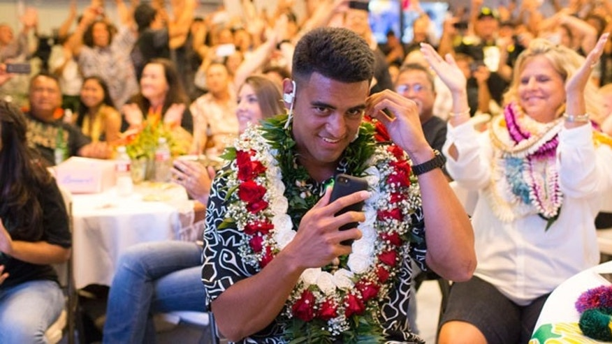Apr. 30, 2015: Former Oregon quarterback Marcus Mariota reacts to being drafted by the Tennessee Titans with the second pick in the first round on NFL Draft Day in Honolulu. (AP)
