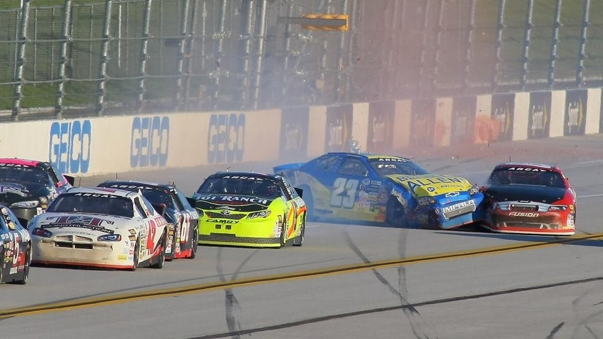 Blake Jones (23) slams into Will Kimmel (69) on the back straight during the ARCA Series auto race at Talladega Superspeedway, Friday, May 1, 2015, in Talladega, Ala. (AP Photo/Greg McWilliams)