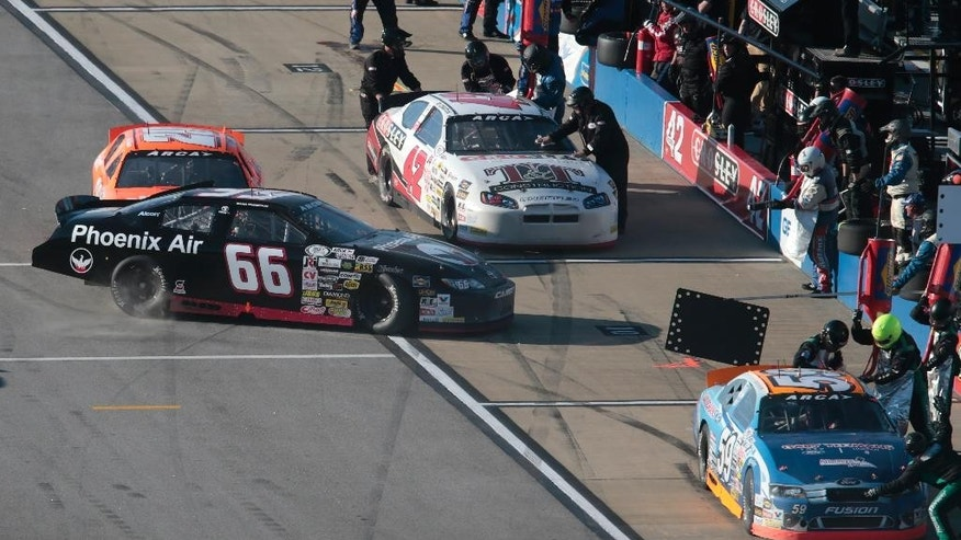 Scott Sheldon (20) hits Mark Thompson (66) on pit road during the ARCA Series auto race at Talladega Superspeedway, Friday, May 1, 2015, in Talladega, Ala. (AP Photo/Butch Dill)