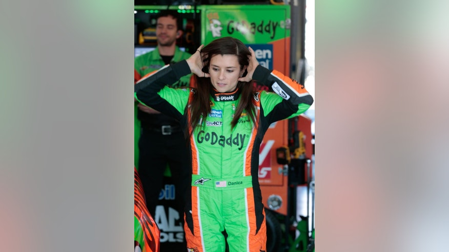 Danica Patrick prepares to enter her race car during practice for the NASCAR Sprint Cup Series auto race at Talladega Superspeedway, Friday, May 1, 2015, in Talladega, Ala. (AP Photo/Butch Dill)