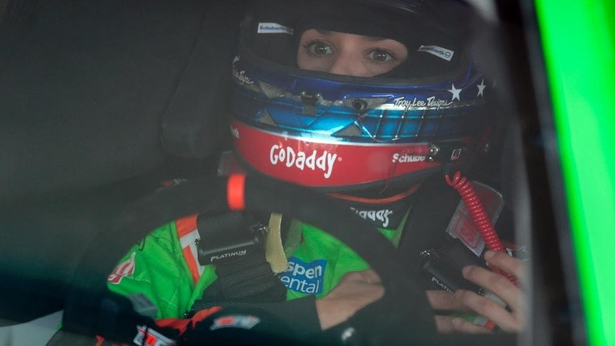 Danica Patrick fastens her helmet during practice for the NASCAR Sprint Cup Series auto race at Talladega Superspeedway, Friday, May 1, 2015, in Talladega, Ala. (AP Photo/Butch Dill)