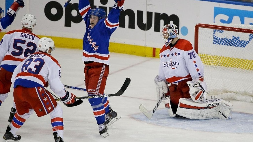 New York Rangers right wing Jesper Fast (19) celebrates a goal by the Rangers against Washington Capitals goalie Braden Holtby (70) during the third period of Game 1 in the second round of the NHL Stanley Cup hockey playoffs Thursday, April 30, 2015, in New York. (AP Photo/Frank Franklin II)
