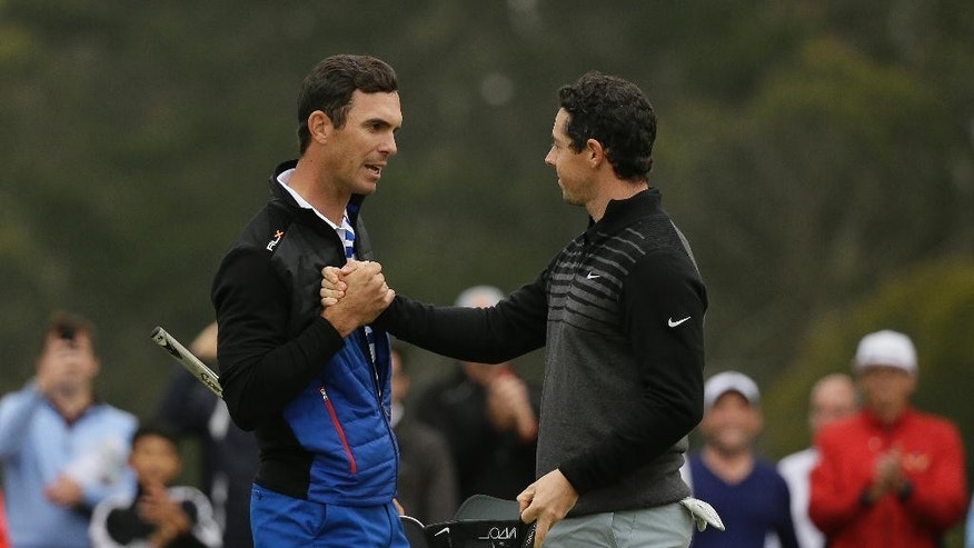 Billy Horschel, left, and Rory McIlroy, right, of Northern Ireland, greet each at the end of their match at TPC Harding Park during round-robin play of the Match Play Championship golf tournament Friday, May 1, 2015, in San Francisco. McIlroy won the match. (AP Photo/Eric Risberg)