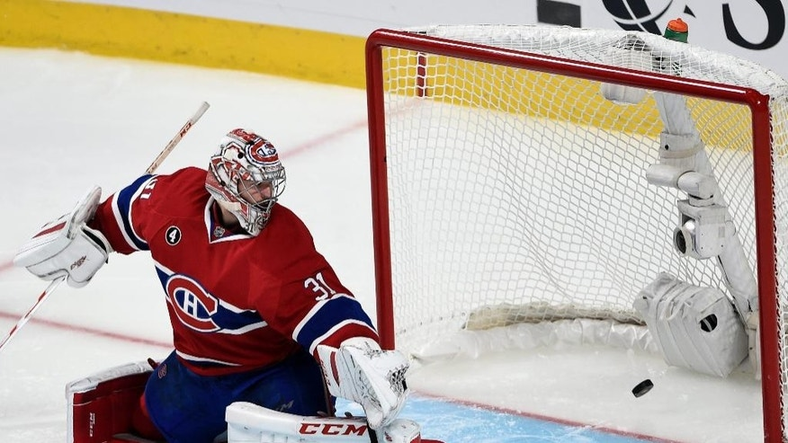 Montreal Canadiens goalie Carey Price lets in the winning goal by Tampa Bay Lightning right wing Nikita Kucherov during the second overtime of Game 1 of second-round playoff NHL hockey action Friday, May 1, 2015, in Montreal. (Ryan Remiorz/The Canadian Press via AP) MANDATORY CREDIT