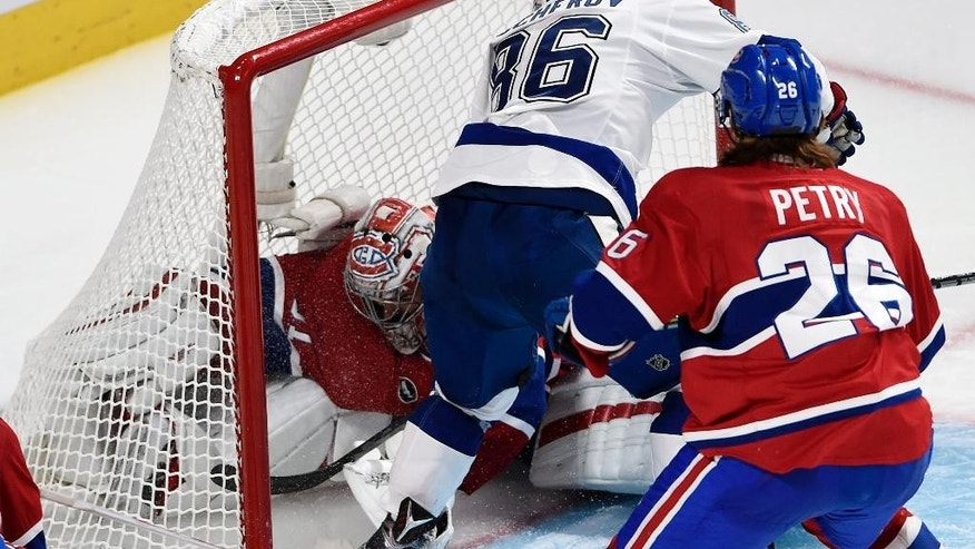 Tampa Bay Lightning right wing Nikita Kucherov (86) scores a disallowed goal against Montreal Canadiens goalie Carey Price (31) as Canadiens defenseman Jeff Petry (26) looks on during overtime of Game 1 of second-round playoff NHL hockey action Friday, May 1, 2015, in Montreal. (Ryan Remiorzs/The Canadian Press via AP) MANDATORY CREDIT