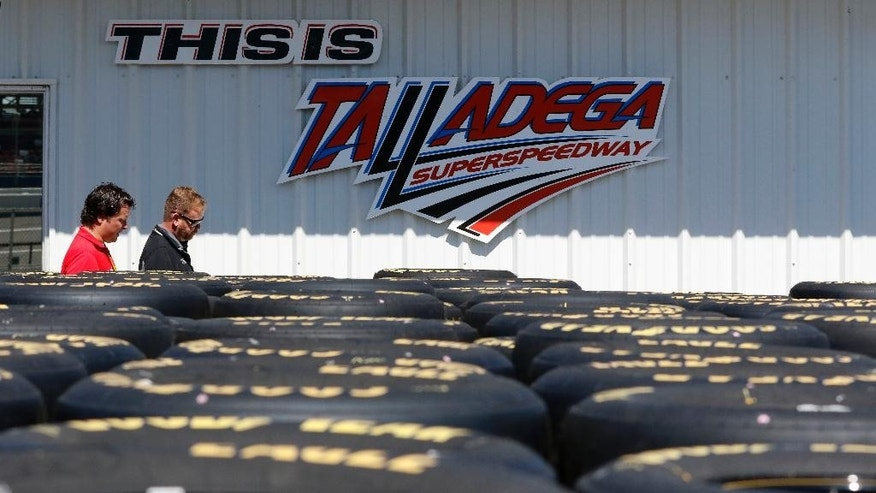 Stacks of tires await drivers during practice for the NASCAR Sprint Cup Series auto race at Talladega Superspeedway, Friday, May 1, 2015, in Talladega, Ala. (AP Photo/Butch Dill)
