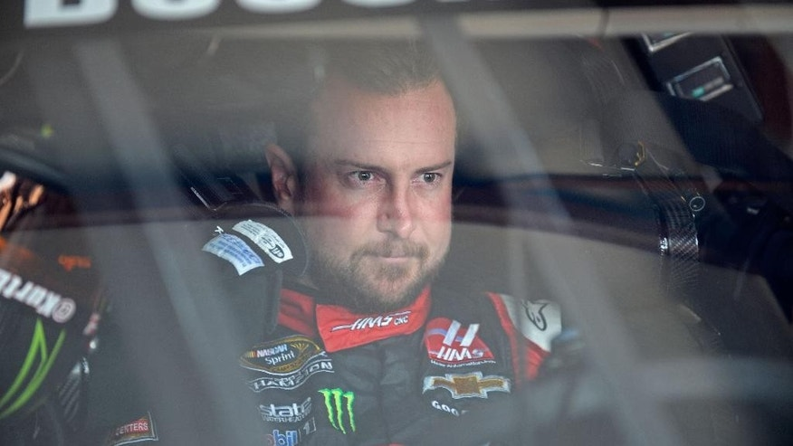 Kurt Busch straps into his race car during practice for the NASCAR Sprint Cup Series auto race at Talladega Superspeedway, Friday, May 1, 2015, in Talladega, Ala. (AP Photo/David Tulis)