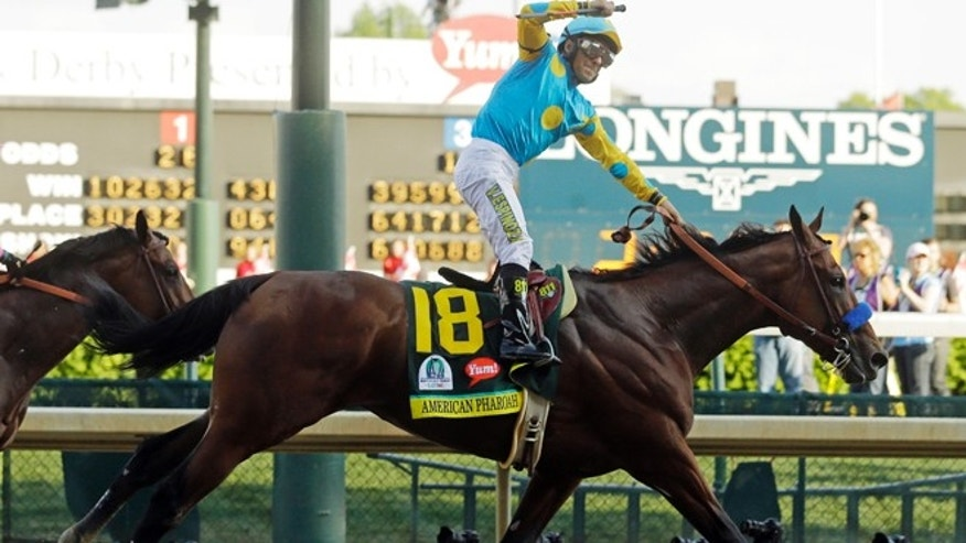 May 2, 2015: Victor Espinoza rides American Pharoah to victory in the 141st running of the Kentucky Derby horse race at Churchill Downs in Louisville, Ky. (AP)