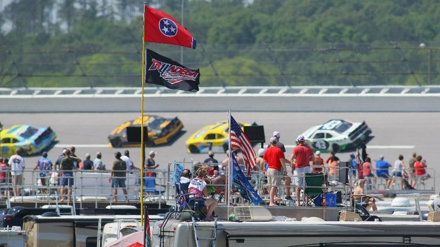 Race fans watch as drivers enter the third turn during the NASCAR Xfinity Series auto race at Talladega Superspeedway, Saturday, May 2, 2015, in Talladega, Ala. (AP Photo/Greg McWilliams)