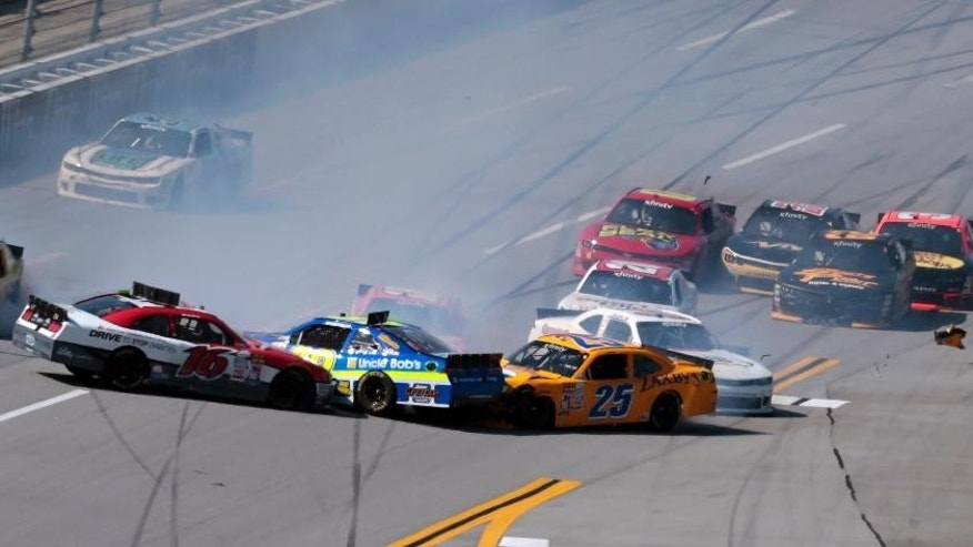 Ryan Reed (16), Ryan Sieg, center, and John Wes Townley (25) crash during the NASCAR Xfinity Series auto race at Talladega Superspeedway, Saturday, May 2, 2015, in Talladega, Ala. (AP Photo/Butch Dill)