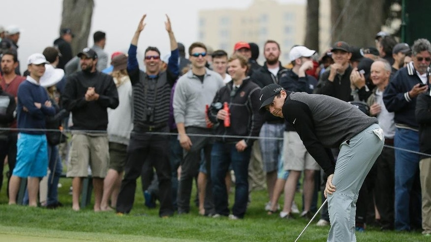 Rory McIlroy of Northern Ireland reacts after missing a birdie putt on the 19th hole of TPC Harding Park during round-robin play against Billy Horschel at the Match Play Championship golf tournament Friday, May 1, 2015, in San Francisco. McIlroy won the match on the 20th hole. (AP Photo/Eric Risberg)