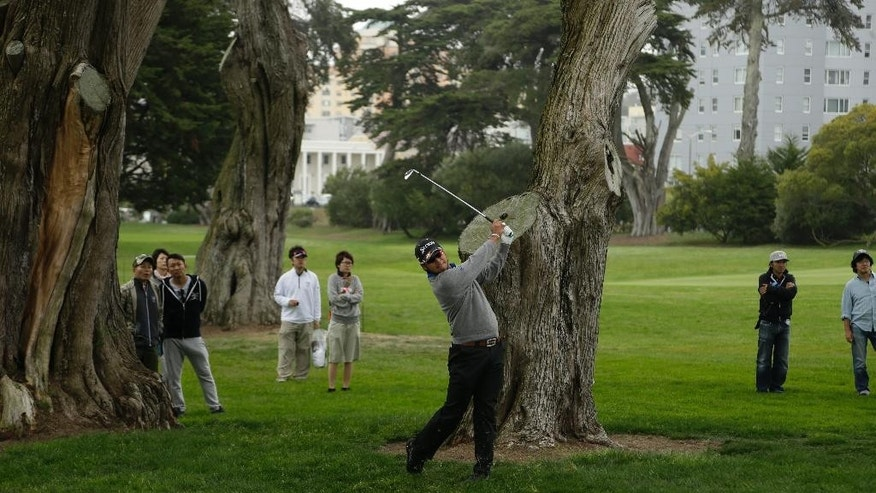 Hideki Matsuyama, of Japan, hits out of the rough on the fourth fairway of TPC Harding Park during round three of the Match Play Championship golf tournament Friday, May 1, 2015, in San Francisco. (AP Photo/Ben Margot)