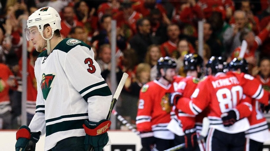 Minnesota Wild center Charlie Coyle (3) reacts after Chicago Blackhawks center Teuvo Teravainen scored his goal during the second period of Game 1 in the second round of the NHL Stanley Cup hockey playoffs in Chicago, Friday, May 1, 2015. (AP Photo/Nam Y. Huh)