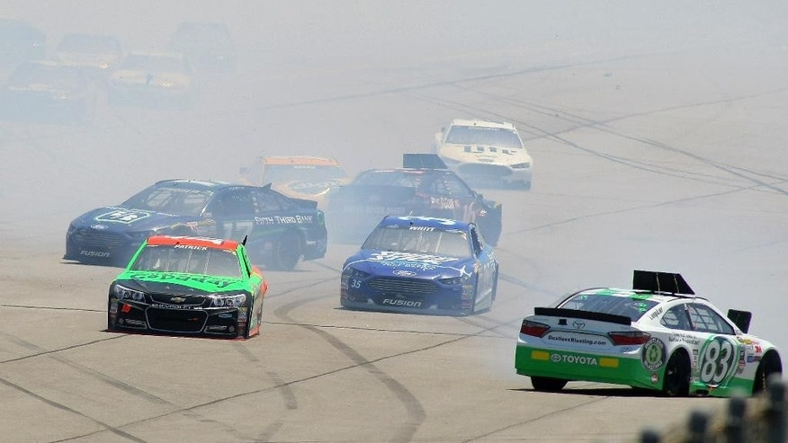 Ricky Stenhouse Jr. (17), Danica Patrick (10), Cole Whitt (35) and Matt DiBenedetto (83) are involved in a multi-car crash on the back straight during the Talladega 500 NASCAR Sprint Cup Series auto race at Talladega Superspeedway, Sunday, May 3, 2015, in Talladega, Ala. (AP Photo/Greg McWilliams)