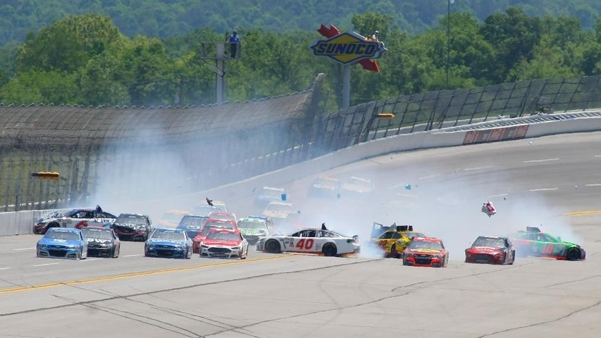 Trevor Bayne (6), Landon Cassill (40), Joey Logano (22), Danica Patrick (10) and others are involved in a multi-car crash during the Talladega 500 NASCAR Sprint Cup Series auto race at Talladega Superspeedway, Sunday, May 3, 2015, in Talladega, Ala. (AP Photo/Greg McWilliams)