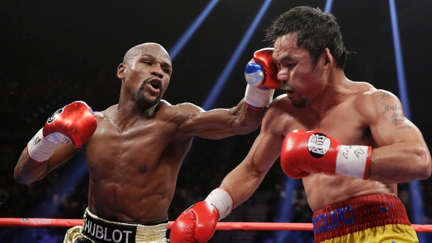 May 2, 2015: Floyd Mayweather Jr., left, hits Manny Pacquiao, from the Philippines, during their welterweight title fight.