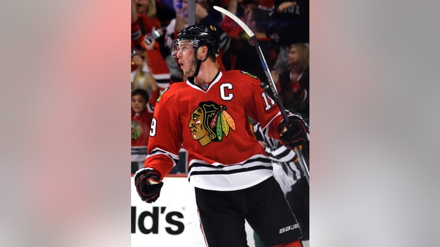 Chicago Blackhawks center Jonathan Toews celebrates after scoring his goal against the Minnesota Wild during the second period  of Game 2 in the second round of the NHL Stanley Cup hockey playoffs in Chicago, Sunday, May 3, 2015. (AP Photo/Nam Y. Huh)