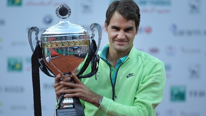 Roger Federer of Switzerland celebrates with his trophy after beating Pablo Cuevas of Uruguay following the final match of the Istanbul Open tennis tournament at Garanti Koza Arena in Istanbul, Turkey, Sunday, May 3, 2015. The Istanbul Open was the first ever ATP World Tour event in Turkey. (AP Photo)