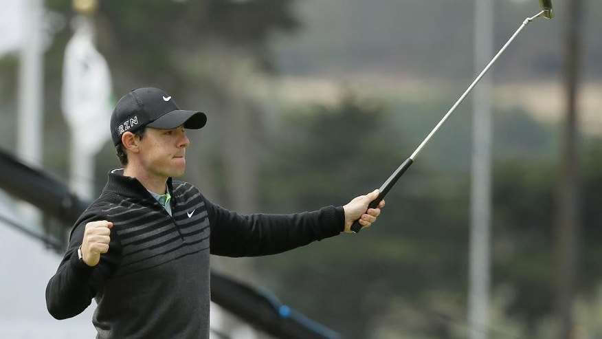 Rory McIlroy, of Northern Ireland, reacts after making an eagle putt on the 18th green of TPC Harding Park to win his semifinal match against Jim Furyk at the Match Play Championship golf tournament Sunday, May 3, 2015, in San Francisco. (AP Photo/Eric Risberg)