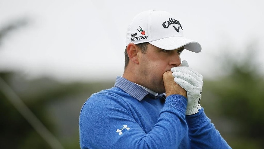 Gary Woodland warms his hands before hitting from the 13th tee of TPC Harding Park against Danny Willett, of England, in the semifinals of the Match Play Championship golf tournament Sunday, May 3, 2015, in San Francisco. Woodland won the match. (AP Photo/Eric Risberg)