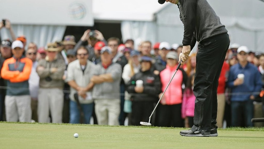 Rory McIlroy, of Northern Ireland, makes an eagle putt on the 18th green of TPC Harding Park to win his semifinal match against Jim Furyk at the Match Play Championship golf tournament Sunday, May 3, 2015, in San Francisco. (AP Photo/Eric Risberg)