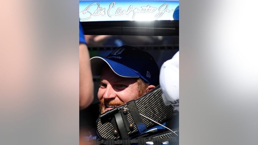 FILE - In this May 3, 2015, file photo, driver Dale Earnhardt Jr. smiles as he pulls into Victory Lane after winning the Talladega 500 NASCAR Sprint Cup Series auto race at Talladega Superspeedway in Talladega, Ala. (AP Photo/David Tulis, File)