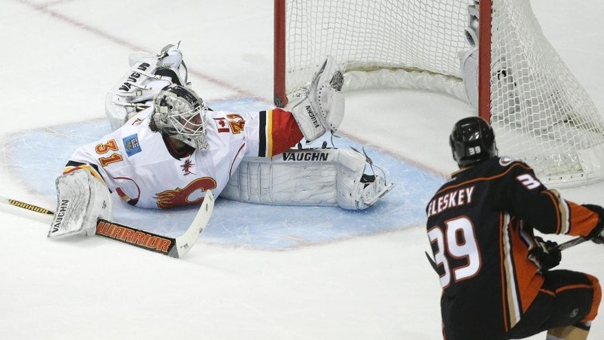 Anaheim Ducks' Matt Beleskey, right, scores against Calgary Flames goalie Karri Ramo, of Finland, during the first period of Game 2 in the second round of the NHL Stanley Cup hockey playoffs, Sunday, May 3, 2015, in Anaheim, Calif. (AP Photo/Jae C. Hong)
