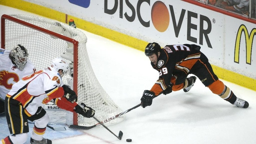 Anaheim Ducks' Matt Beleskey, right, is defended by Calgary Flames' Sam Bennett during the first period of Game 2 in the second round of the NHL Stanley Cup hockey playoffs, Sunday, May 3, 2015, in Anaheim, Calif. (AP Photo/Jae C. Hong)