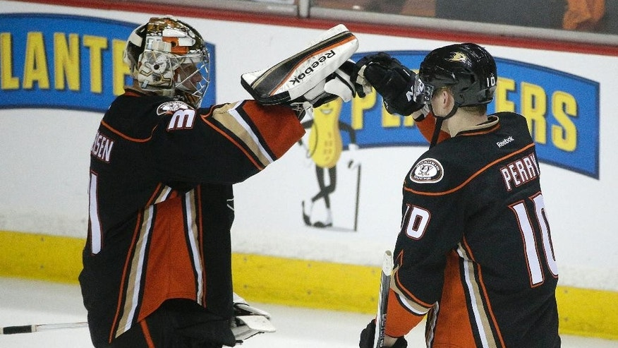 Anaheim Ducks' Corey Perry, right, and goalie Frederik Andersen, of Denmark, celebrate the team's 3-0 win against the Calgary Flames in Game 2 in the second round of the NHL Stanley Cup hockey playoffs, Sunday, May 3, 2015, in Anaheim, Calif. (AP Photo/Jae C. Hong)