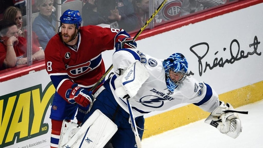 Montreal Canadiens winger Brandon Prust (8) runs into Tampa Bay Lightning goalie Ben Bishop (30) during third period of Game 2 NHL second round playoff hockey action Sunday, May 3, 2015 in Montreal. (Ryan Remiorz/The Canadian Press via AP)