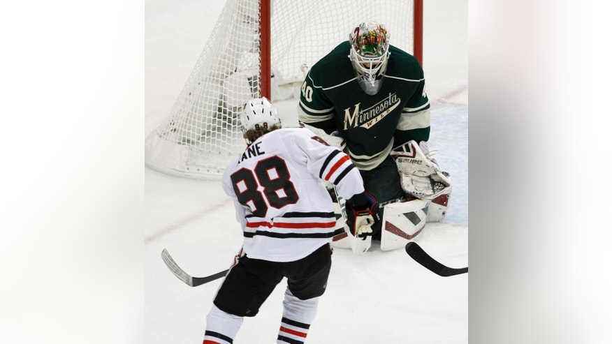 Chicago Blackhawks right wing Patrick Kane (88) scores on Minnesota Wild goalie Devan Dubnyk (40) during the first period of Game 3 in the second round of the NHL Stanley Cup hockey playoffs in St. Paul, Minn., Tuesday, May 5, 2015. (AP Photo/Ann Heisenfelt)