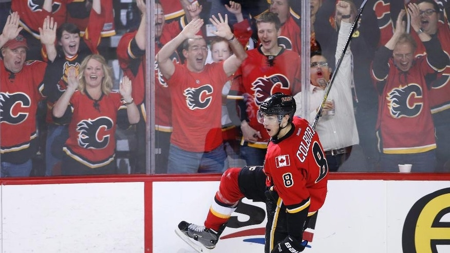 Calgary Flames' Joe Colborne (8) celebrates his goal against the Anaheim Ducks during the second period of Game 3 in the second round of the NHL Stanley Cup hockey playoffs, Tuesday, May 5, 2015, in Calgary, Alberta. (AP Photo/The Canadian Press, Larry MacDougal)