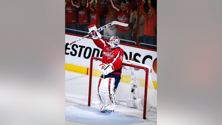 Washington Capitals goalie Braden Holtby (70) celebrates after Game 4 in the second round of the NHL Stanley Cup hockey playoffs against the New York Rangers, Wednesday, May 6, 2015, in Washington.  The Capitals won 2-1. (AP Photo/Alex Brandon)