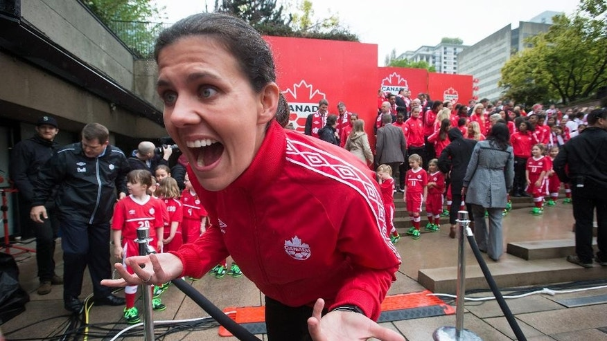 FILE - In this April 27, 2015, file photo, Canadian national women's soccer team captain Christine Sinclair  jokes with her niece after the roster for the 2015 FIFA Women's World Cup was announced in Vancouver. Sinclair is doubling as both striker and ambassador for Canada when her native country hosts the Women's World Cup starting in June. No doubt there's mounting pressure, but so far Sinclair isn't letting it get to her.(Darryl Dyck/The Canadian Press via AP, File)