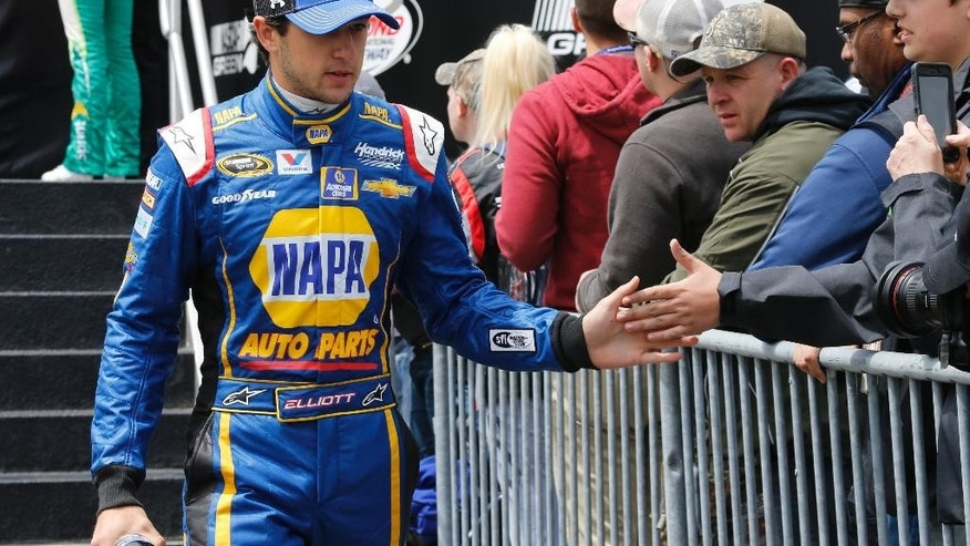 FILE - In this April 26, 2015, file photo, Sprint Cup driver Chase Elliott greets fans during driver introductions prior to the start of the NASCAR Sprint Cup auto race at Richmond International Raceway in Richmond, Va. Chase Elliott is bringing NAPA's sponsorship with him to the Sprint Cup Series. Hendrick Motorsports announced Wednesday, May 6, 2015,  that NAPA has signed a three-year deal to be the majority sponsor for Elliott, who will replace four-time NASCAR champion Jeff Gordon in the No. 24 Chevrolet next season. (AP Photo/Steve Helber)