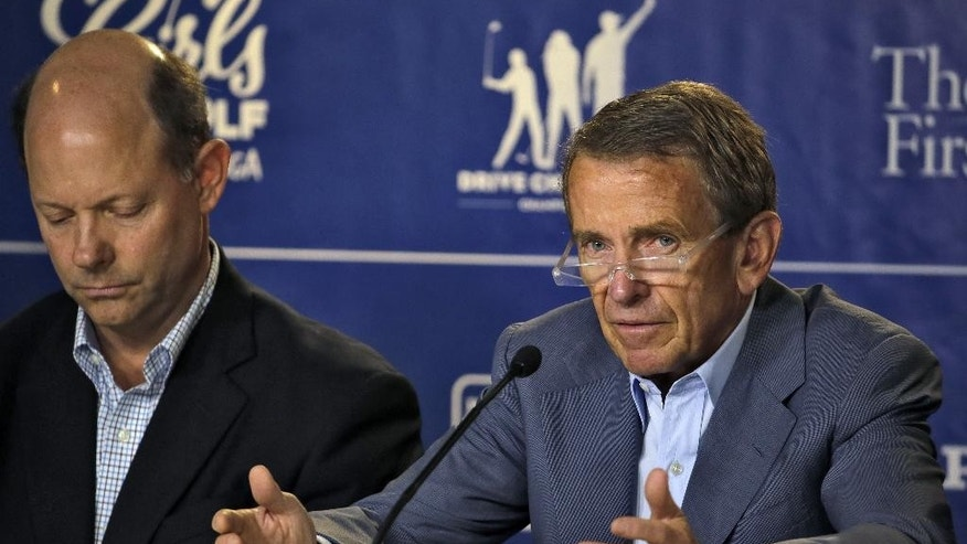 PGA Tour Commissioner Tim Finchem, right, gestures during a golf industry news conference at The Players Championship golf tournament Wednesday, May 6, 2015, in Ponte Vedra Beach, Fla. Looking on is Mike Davis, Executive Director of the USGA. (AP Photo/Chris O'Meara)