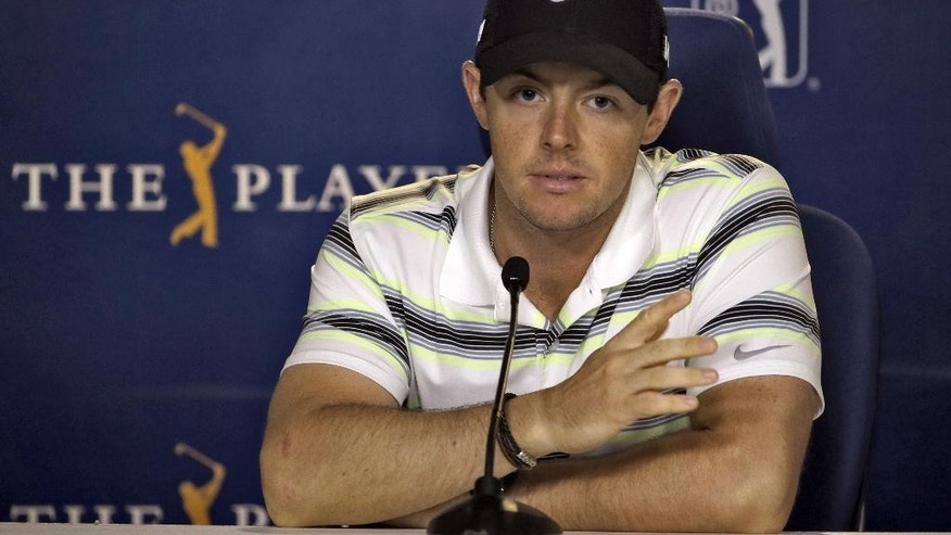Rory McIlroy, of Northern Ireland, gestures as he answers a question during a news conference before practice at The Players Championship golf tournament Wednesday, May 6, 2015, in Ponte Vedra Beach, Fla. (AP Photo/Chris O'Meara)