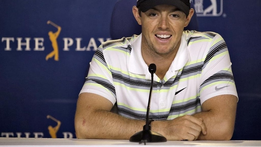 Rory McIlroy, of Northern Ireland, smiles during a news conference before practice at The Players Championship golf tournament Wednesday, May 6, 2015, in Ponte Vedra Beach, Fla. (AP Photo/Chris O'Meara)