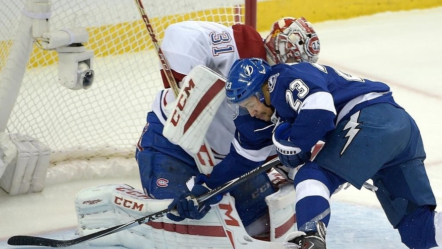 Montreal Canadiens goalie Carey Price (31) blocks a shot attempt by Tampa Bay Lightning right wing J.T. Brown (23) during the first period of Game 3 of a second-round NHL Stanley Cup hockey playoff series in Tampa, Fla., Wednesday, May 6, 2015.(AP Photo/Phelan M. Ebenhack)