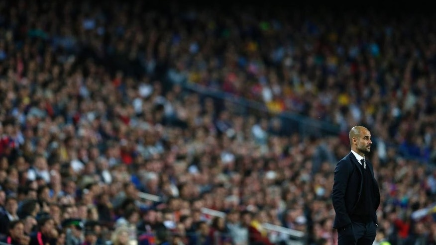 Bayern's head coach Pep Guardiola watches the Champions League semifinal first leg soccer match between Barcelona and Bayern Munich at the Camp Nou stadium in Barcelona, Spain, Wednesday, May 6, 2015.  (AP Photo/Manu Fernandez)